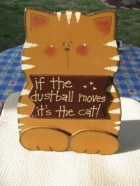 36910T  If the Dustballs moves...it's the cat!  Wood sitting sign