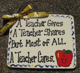 5113AT- A Teacher Gives A Teacher Shares  But most of all a teacher cares wood sign